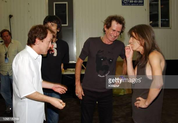 Angus Young of AC/DC Ron Wood and Keith Richards of The Rolling Stones with Malcolm Young of AC/DC