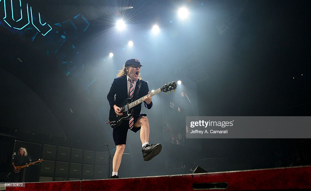 Angus Young performs with AC/DC during the Rock Or Bust Tour at the Greensboro Coliseum on August 27, 2016 in Greensboro, North Carolina.