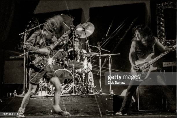 Angus Young Phil Rudd and Mark Evans of AC/DC performing on stage Lyceum Theatre London United Kingdom on July 7 1976 from the Lock Up Your Daughters...