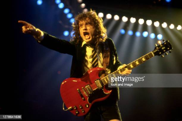 Angus Young, the Australian musician, best known as the co-founder, lead guitarist, and songwriter of the Australian hard rock band AC/DC, onstage at...