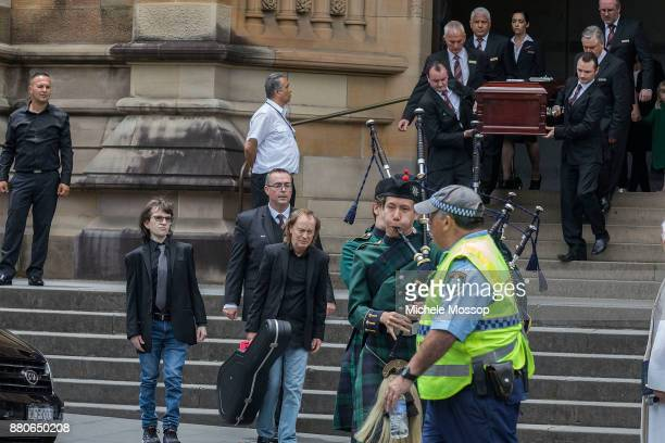 Angus Young with nephew Ross son of Malcom follow his brother's coffin out at the funeral service for AC/DC cofounder Malcolm Young at St Mary's...