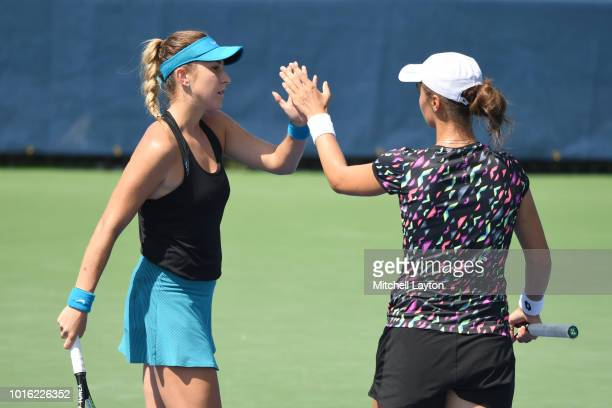 Anhelina Kalinina of the Ukraine and Belinda Bencic of Croatia celebrate a point during the Women's Doubles semifinal against Xinyun Han of China and...