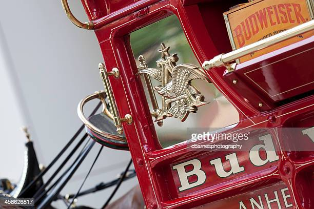 Anheuser-Busch logo and Budweiser brand name on beer wagon