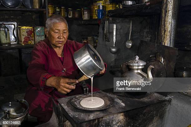 Ani Chorten daughter of Tashi Lama is preparing buckwheat pancakes in Praken Gompa