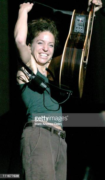 Ani DiFranco performs during torrential rainstorms to support the Goo Goo Dolls as they filmed a music DVD before their hometown crowd