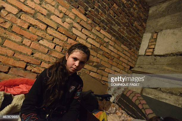 Ania 11yearsold sits waiting for the end of the shelling in Donetsk's Petrovski district in the eastern Ukraine on February 4 2015 Donetsk's Children...