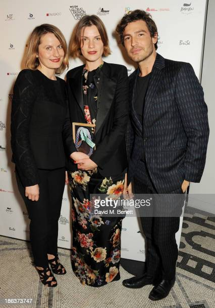 Ania Wiacek and Mia Castenskjold winners of the Menswear Design Team award and Robert Konjic pose backstage at The WGSN Global Fashion Awards at the...