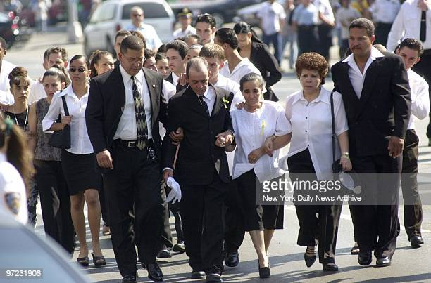 Anibal and Maria Pea parents of Maria Herrera and Dilcie Pea are escorted from St Michael's Church in Brooklyn after the funeral of family killed by...