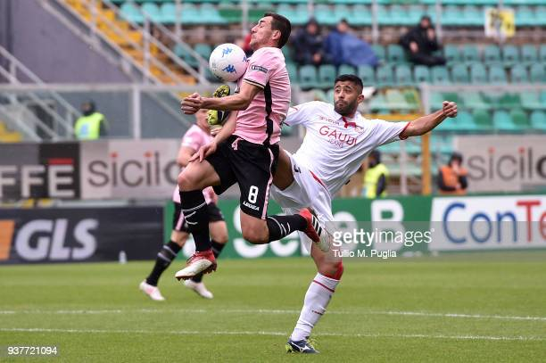 Anibal Capela of Carpi fouls Mato Jajalo of Palermo during the serie B match between US Citta di Palermo and Carpi FC at Stadio Renzo Barbera on...