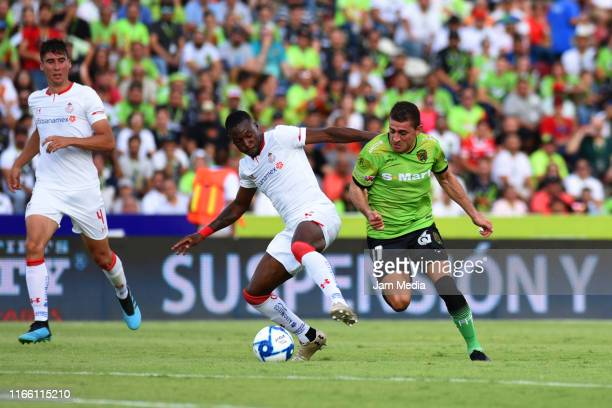 Anibal Chala of Toluca fights for the ball with Flavio Santos of Juarez during the 3rd round match between FC Juarez and Toluca as part of the Torneo...