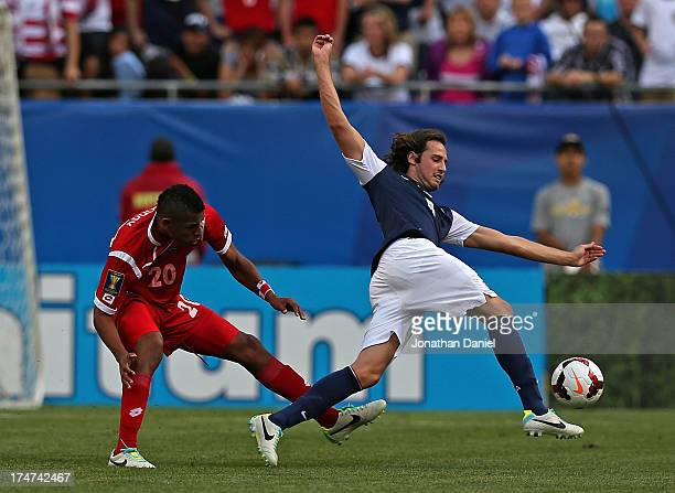 Anibal Godoy of Panama trips Mix Diskerud of the United States during the CONCACAF Gold Cup final match at Soldier Field on July 28 2013 in Chicago...