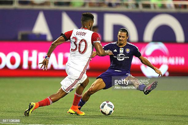 Anibal Godoy of San Jose Earthquakes runs past a leaping Adrian Winter of Orlando City SC during an MLS soccer match between the San Jose Earthquakes...