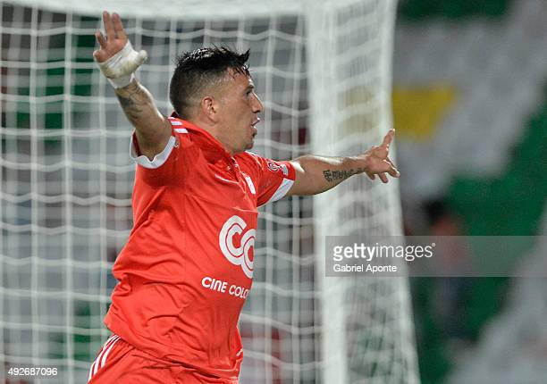 Anibal Hernandez of America de Cali celebrates after scoring the opening goal during a match between Deportes Quindio and America de Cali as part of...
