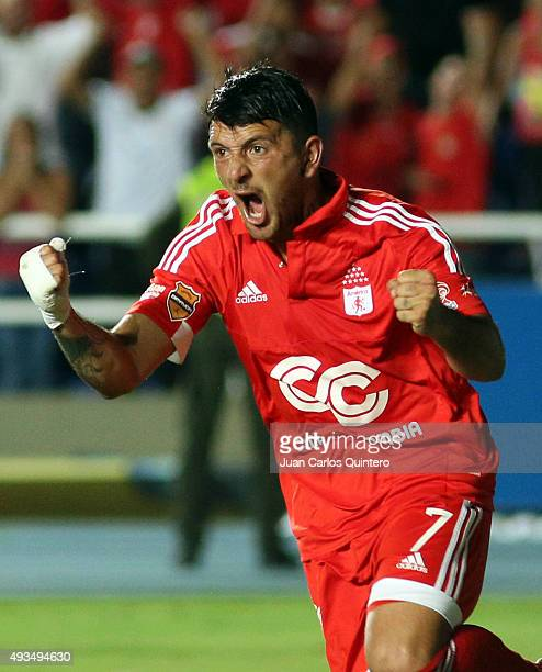 Anibal Hernandez of America de Cali celebrates after scoring the first goal of his team during a match between America de Cali and Llaneros FC as...
