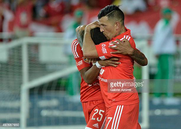 Anibal Hernandez of America de Cali celebrates with Sebastian Viafara after scoring the first goal of his team during a match between Deportes...