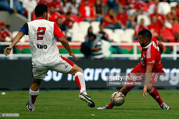 Anibal Hernandez of America fights for the ball with John Garcia of Cucuta during a match between America de Cali and Cucuta as part of round 16 of...