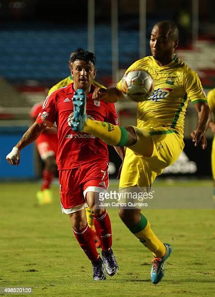 Anibal Hernandez of América and Luis Payares of Bucaramanga battle for the ball during a match between America de Cali and Bucaramanga as part of...