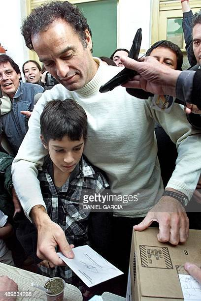 Anibal Ibarra, Alliance candidate for head of the government of the city of Buenos Aires, accompanied by his son Pablo, deposits his vote 07 May...