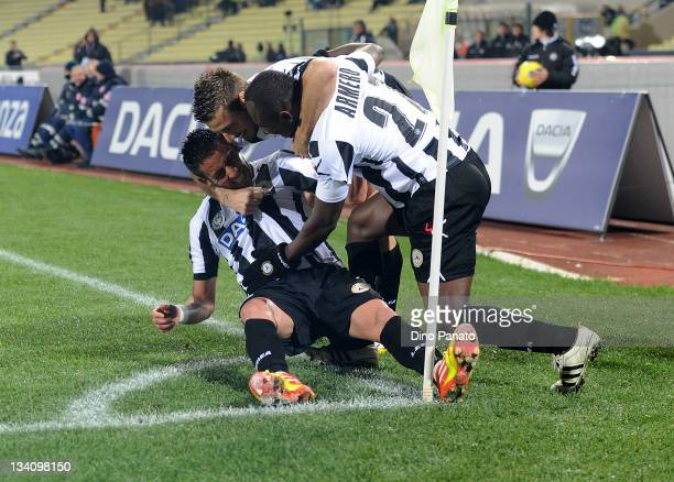 Anibal Isla of Udinese celebrates with teammate after scoring his team's second goal during the Serie A match between Udinese Calcio and AS Roma at...