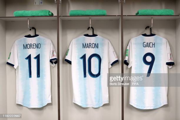 Anibal Moreno Gonzalo Maroni and Adolfo Gaich of Argentina shirts are seen hanging in the changing room prior to the 2019 FIFA U20 World Cup group F...