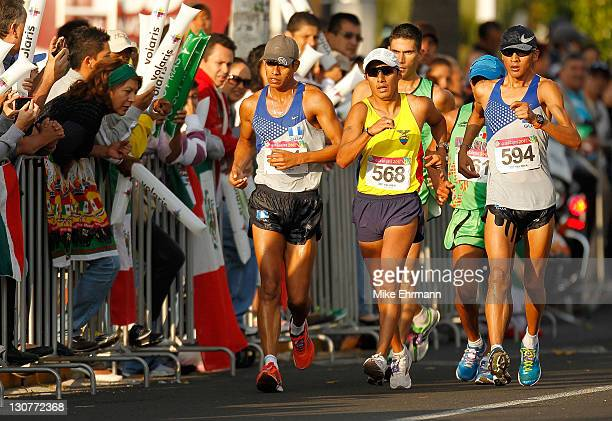 Anibal Paau and Jaime Quiyuch of Guatamala and Cristian Chocho of Venezuela race walk during Day 15 of the XVI Pan American Games at the Race Walk...