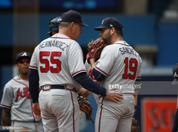 Anibal Sanchez of the Atlanta Braves is visited on the mound by pitching coach Chuck Hernandez in the fifth inning during MLB game action against the...