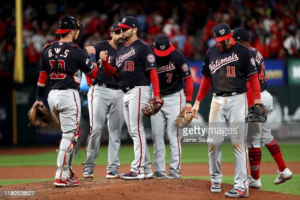 Anibal Sanchez of the Washington Nationals is congratulated by his teammates after losing his nohit bid with two outs in the eighth inning against...