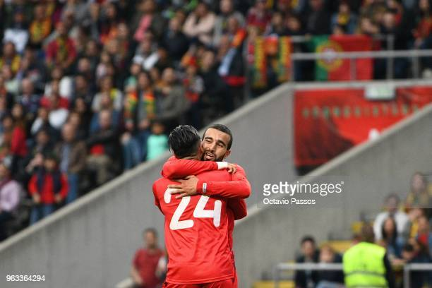 Anice Badri celebrates with Naim Sliti of Tunisia after scoring a goal during the international friendly football match against Portugal and Tunisia...