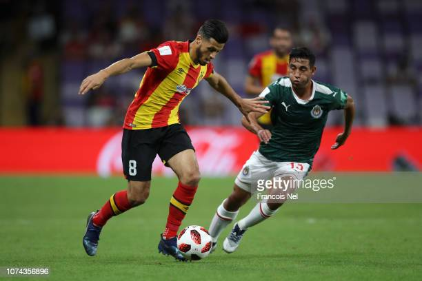 Anice Badri of ES Tunis battles for possession with Walter Sandoval of CD Guadalajara during the FIFA Club World Cup UAE 2018 5th Place Match between...