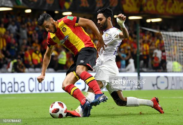 Anice Badri of ES Tunis is challenged by Hussein El Shahat of Al Ain during the FIFA Club World Cup UAE 2018 Second round match between ES Tunis v Al...