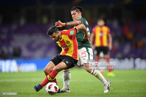 Anice Badri of ES Tunis is challenged by Michael Perez of CD Guadalajara during the FIFA Club World Cup UAE 2018 5th Place Match between ES Tunis and...