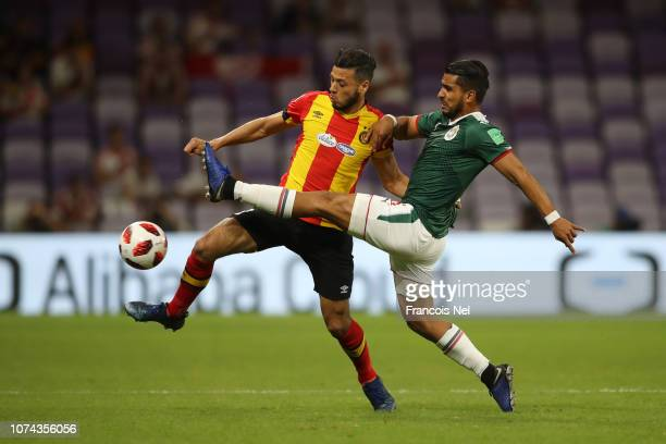 Anice Badri of ES Tunis is challenged by Miguel Ponce of CD Guadalajara during the FIFA Club World Cup UAE 2018 5th Place Match between ES Tunis and...