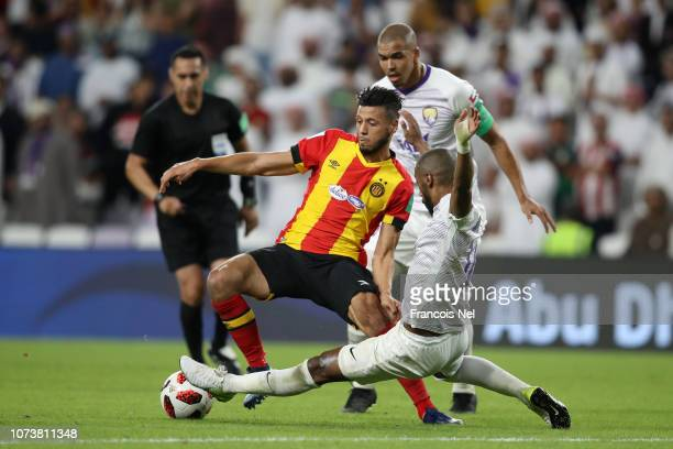 Anice Badri of ES Tunis is tackled by Mohammed Fayez of Al Ain during the FIFA Club World Cup UAE 2018 Second round match between ES Tunis v Al Ain...