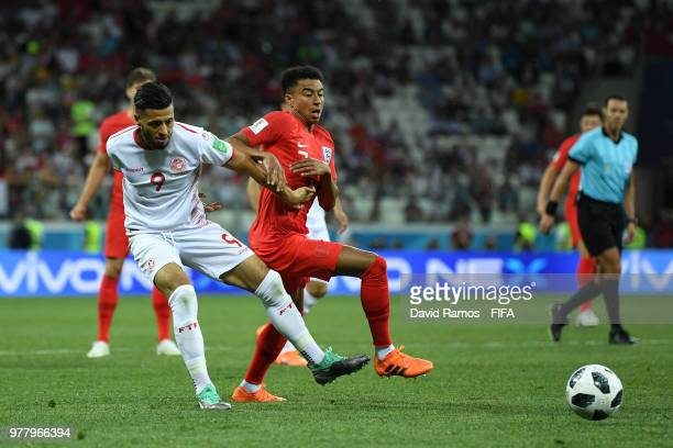 Anice Badri of Tunisia is challenged by Jesse Lingard of England during the 2018 FIFA World Cup Russia group G match between Tunisia and England at...