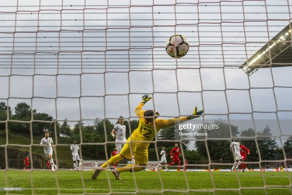 Anice Badri of Tunisia scores a goal past Anthony Lopes of Portugal during the international friendly football match against Portugal and Tunisia at the Municipal stadium de Braga on May 28, 2018 in Braga, Portugal.