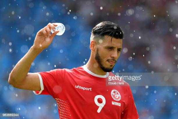 Anice Badri of Tunisia throws a bottle of water during the 2018 FIFA World Cup Russia group G match between Belgium and Tunisia at Spartak Stadium on...