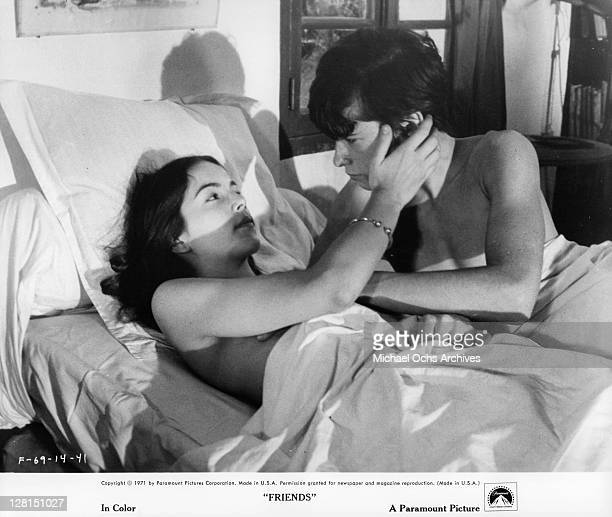 Anicee Alvina and Sean Bury in bed together in a scene from the film 'Friends' 1971