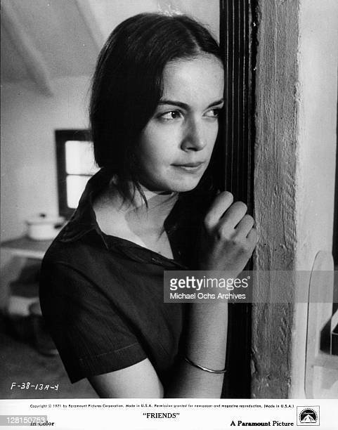 Anicee Alvina leaning against the wall of a doorway in a scene from the film 'Friends' 1971