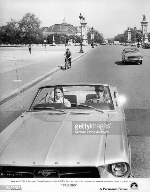 Anicee Alvina rides as a passenger in a car in a scene from the film 'Friends' 1971