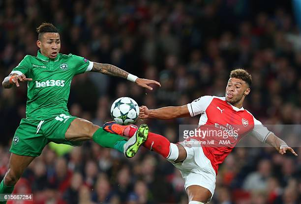 Anicet Abel of Ludogorets and Alex OxladeChamberlain of Arsenal during the UEFA Champions League match between Arsenal FC and PFC Ludogorets Razgrad...