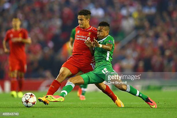 Anicet Abel of PFC Ludogorets Razgrad tackles Philippe Coutinho of Liverpool during the UEFA Champions League Group B match between Liverpool FC and...