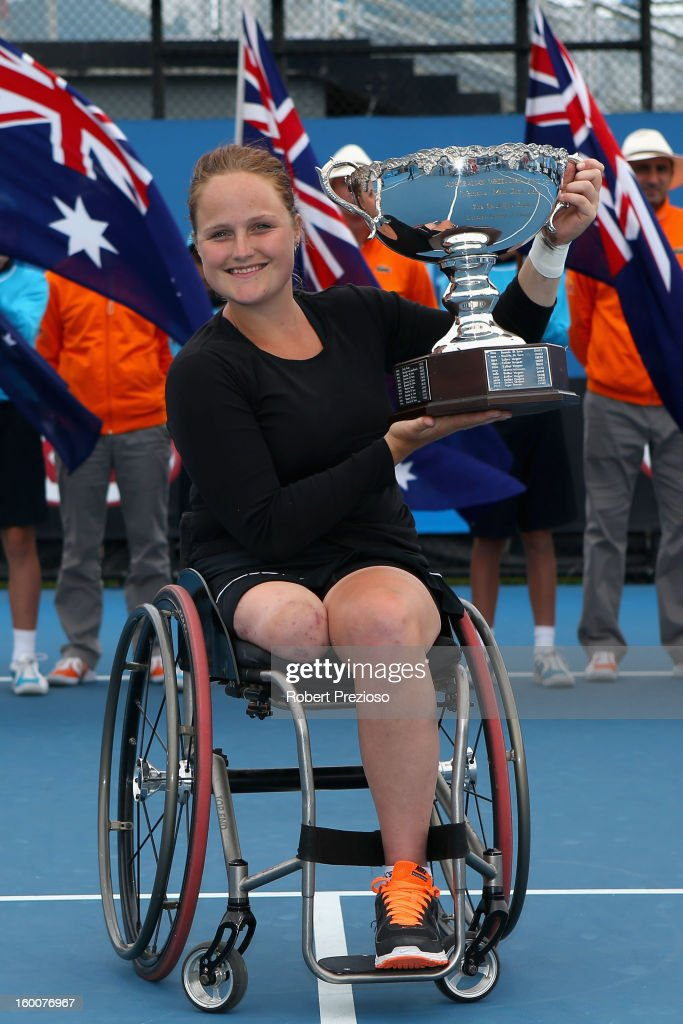 Aniek Van Koot of the Netherlands poses with the championship trophy after winning her Women's Wheelchair Singles Final match against Sabine Ellerbrock of Germany during the 2013 Australian Open Wheelchair Championships at Melbourne Park on January 26, 2013 in Melbourne, Australia.