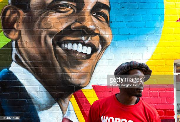 Aniekan Udofia using mostly spray paint teams with MuralsDC to create a mural on the side of Ben's Chili Bowl featuring President Barack Obama Monday...