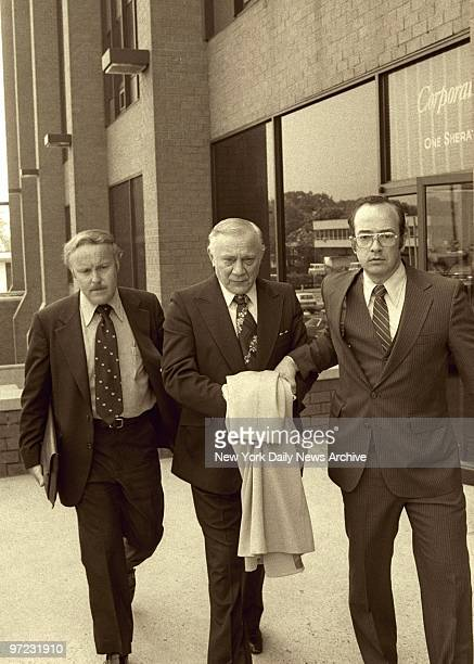 Aniello Dellacroce is escorted from FBI headquarters in New Rochelle