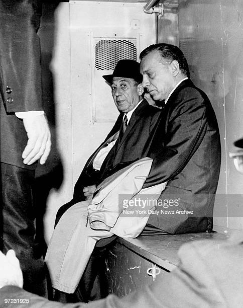 Aniello Dellacroce sits in police wagon with fellow mob figure Anthony Corallo