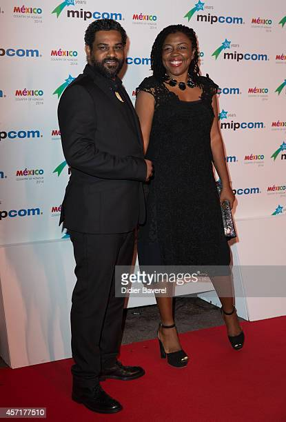 Anieph Latchman and Alison Latchman attend the opening red carpet party MIPCOM 2014 at Hotel Martinez on October 13 2014 in Cannes France