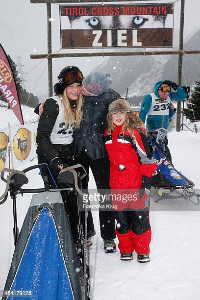 Anika Bormann Gedeon Burkhard and Gioia Filomena Burkhard attend the Sledge Dog Race Tirol Cross Mountain 2013 on December 07 2013 in Innsbruck...
