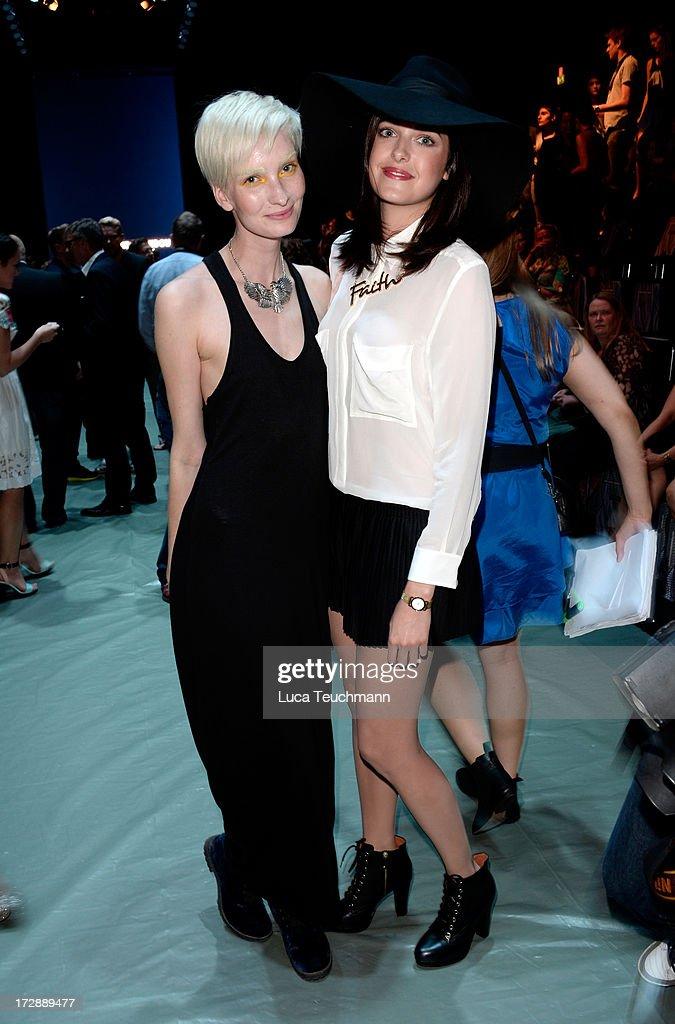 Anika Scheibe and Marie Nasemann attend the Miranda Konstantinidou Arrivals at Brandenburg Gate on July 5, 2013 in Berlin, Germany.