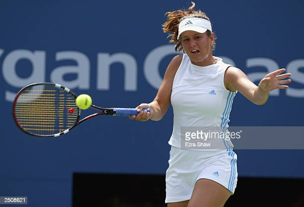 Aniko Kapros of Hungary returns a shot to Justine HeninHardenne of Belgium during the US Open at the USTA National Tennis Center on August 26 2003 in...