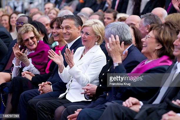 Aniko Levai with her husband Viktor Orban and Liz Mohn attend the opera 'The Magic Flute' at the Thurn Taxis Castle Festival Opening on July 13 2012...